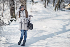 happy woman walking in the winter forest Royalty Free Stock Photo