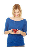 Happy woman with a wallet. Royalty Free Stock Images