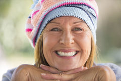Happy Woman with warm beanie hat in winter outdoor Stock Images