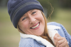 Happy woman warm bonnet and jacket outdoor Royalty Free Stock Photos