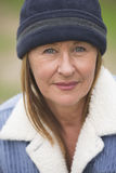 Happy Woman in warm jacket and bonnet portrait Royalty Free Stock Image