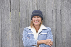 Happy woman warm jacket timber background Royalty Free Stock Images