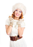 A happy woman in warm winter clothes on white Royalty Free Stock Image