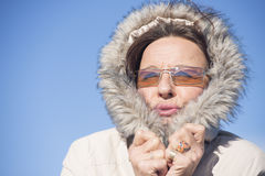 Happy Woman warm winter jacket Stock Image