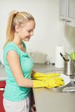 Happy woman washing dishes at home kitchen Stock Photo