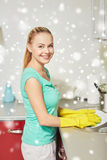 Happy woman washing dishes at home kitchen Royalty Free Stock Photo