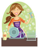 Happy woman washing dishes Royalty Free Stock Photo