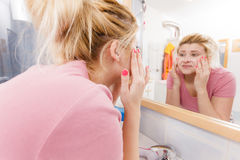 Happy woman washing her face under sink Stock Photography