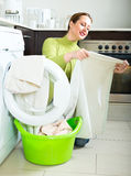 Happy woman washing towels Royalty Free Stock Image