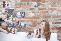 Happy woman watching her pictures Stock Photo