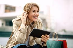 Woman watching media content in a digital tablet. Happy woman watching media content in a digital tablet Stock Photos