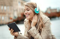 Happy woman watching media content. In a digital tablet Royalty Free Stock Photography