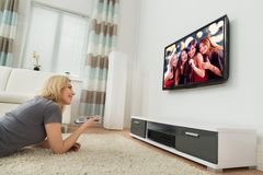 Happy Woman Watching Television At Home Royalty Free Stock Photo