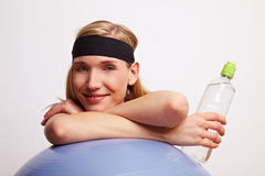 Happy woman with water bottle Royalty Free Stock Photo