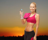 Happy woman with water bottle and towel outdoors Royalty Free Stock Images