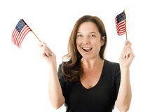 Happy woman waving patriotic American flags Royalty Free Stock Images