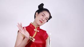 Woman wear cheongsam and saying goobye stock video footage