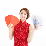 Happy woman wear cheongsam and showing Red envelopes Stock Photo