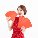 Happy woman wear cheongsam and showing Red envelopes Royalty Free Stock Photo