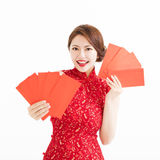 Happy woman wear cheongsam and showing Red envelopes Royalty Free Stock Image