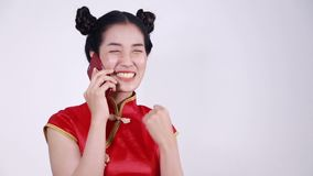 Woman wear cheongsam and using mobile phone stock video