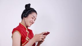Woman wear cheongsam and using mobile phone stock video footage