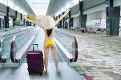 Happy woman wearing bikini in airport hall 1 Stock Image