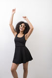 Happy woman wearing black dress. Raised hands Royalty Free Stock Photography