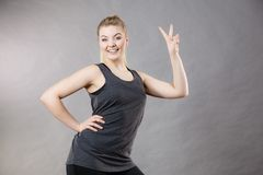 Happy woman wearing black tank top. Smiling having good mood. Sporty outfit Stock Photography