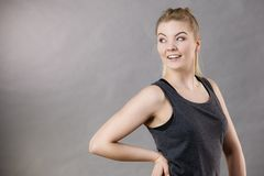 Happy woman wearing black tank top. Smiling having good mood. Sporty outfit Royalty Free Stock Photography