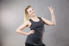 Happy woman wearing black tank top. Smiling having good mood. Sporty outfit Stock Photo