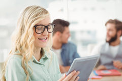 Happy woman wearing eyeglasses holding digital tablet Royalty Free Stock Photography