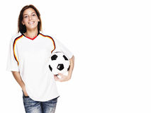 Happy woman wearing football shirt holding footbal. L on white background Royalty Free Stock Image