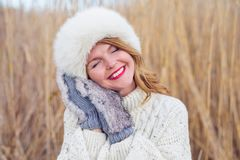 Happy Woman wearing funny and cozy hat and gloves Royalty Free Stock Photo