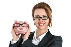 Happy woman wearing glasses holding funny piggybank Stock Photos