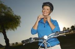 Happy Woman wearing Helmet Stock Image