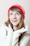Happy woman wearing knitted hat and gloves Royalty Free Stock Image