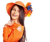 Happy woman wearing orange hat with flower. Autumn fashion Royalty Free Stock Images