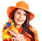 Happy woman wearing orange hat with flower. Royalty Free Stock Photos