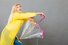 Happy woman wearing raincoat holding transparent umbrella Royalty Free Stock Photo