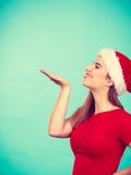 Happy woman wearing Santa Claus helper costume Stock Photo