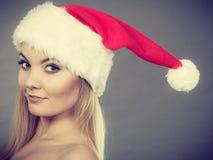 Happy woman wearing Santa Claus helper hat Royalty Free Stock Images