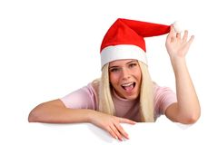 Happy woman wearing a Santa hat Royalty Free Stock Photo