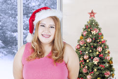Happy woman wearing santa hat in christmas day Stock Images