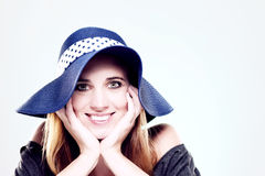 Happy woman wearing a summer hat Stock Photos
