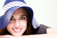 Happy woman wearing a summer hat Stock Photography