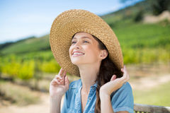 Happy woman wearing sun hat while looking away Royalty Free Stock Photography