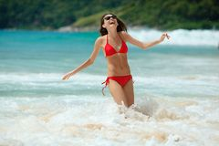 Happy woman wearing sunglasses in water Stock Photos
