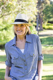 Happy woman wearing sunhat in park Royalty Free Stock Photo