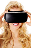 Happy woman wearing virtual reality goggles Royalty Free Stock Images